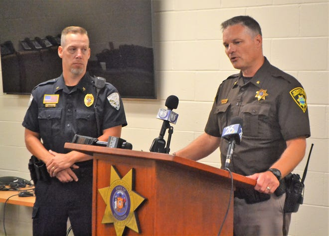 At a news conference Friday, Aug. 6, Oconto County Sheriff Todd Skarban, right, discusses the shooting of an Oconto Falls Police officer Friday morning. Oconto Falls Police Chief Brad Olsen is at left.