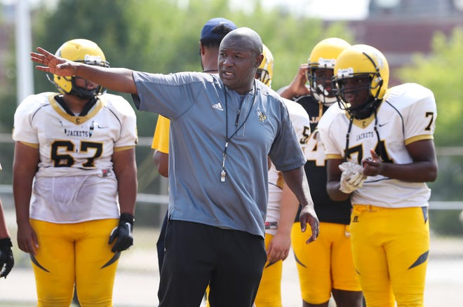 Central High School head coach Marvin Dantzler, center, conducts practice at the school in Louisville, Ky. on Aug. 2, 2021.