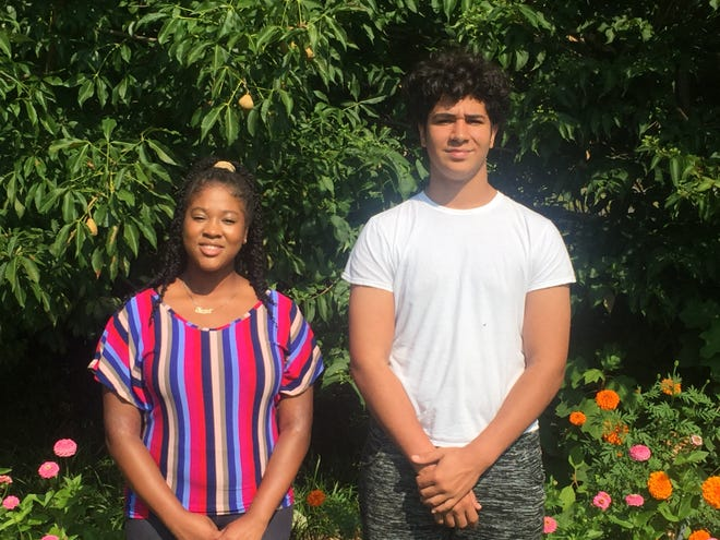 Kanija Green and Gianni Bonham were among children challenged to do one good deed every day for a month.