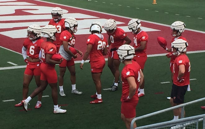 Wisconsin football players wear Guardian Caps on the top of their helmets to help prevent head injuries