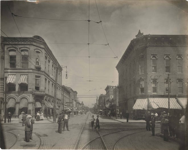 The corner of Main and Walnut streets in downtown Muncie in the early 1900s.