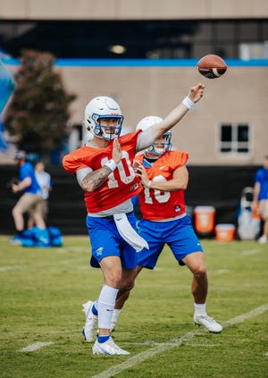 MTSU junior quarterbacks Bailey Hockman (10) and Chase Cunningham (16) are battling for the starting position.