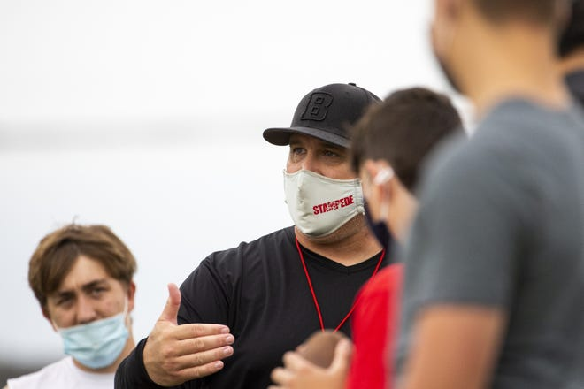 Brophy Prep head coach Jason Jewell talks with players during practice at the Brophy Sports Complex in Phoenix, Ariz. on April 26, 2021.