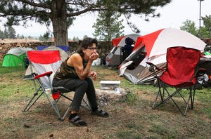 Christi Hazleton sits in the evacuation camp at Lassen Community College in Susanville, Calif. on Aug. 6, 2021. Hazleton and her family fled their home in Greenville due to the Dixie Fire.