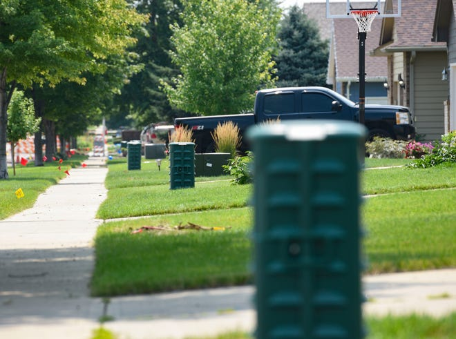 Vast Broadband utility boxes have been installed at regular intervals along property lines on Friday, August 6, 2021 in Sioux Falls.