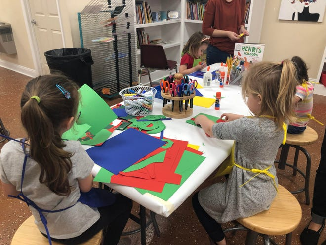 Children enjoy making art projects in the ArtZone.