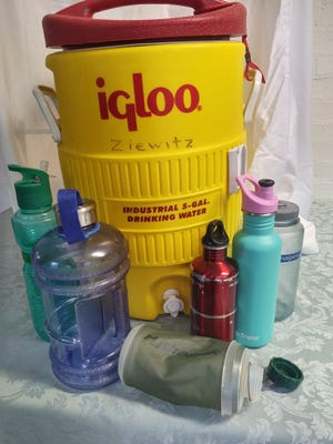 A combination of individual reusable small water bottles and large storage containers can handily hold the drinking water you need to get through a hurricane.