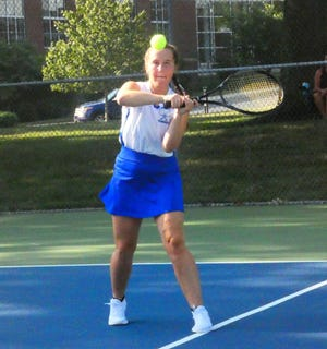 Zanesville's Kamrie Simon hits a backhand return Friday during the season-opening Licking County Tournament at Denison University. Simon and partner Jersey Draughn finished 2-1 at No. 2 doubles.