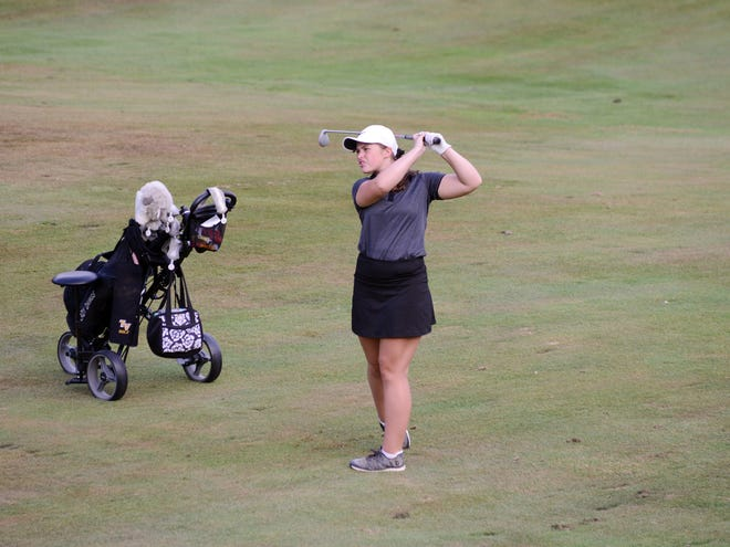 Makayla Hutchison, of Tri-Valley, hits an iron shot on the third hole during the Circle K Invitational earlier this season at EagleSticks. Hutchison recorded a rare double eagle on Monday at Vista.