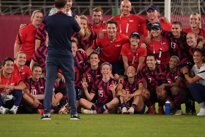 The U.S. women's soccer team celebrates its bronze-medal victory over Australia.