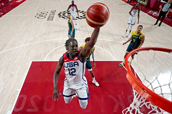Guard Jrue Holiday (12) dunks the ball against Australia during the semifinals at the Tokyo Olympics.