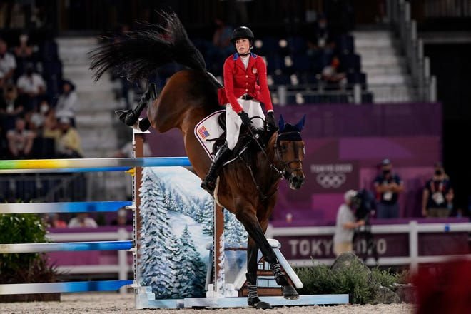 Jessica Springsteen, riding Don Juan van de Donkhoeve, competes during the equestrian jumping team qualifying  at the Tokyo Olympics.