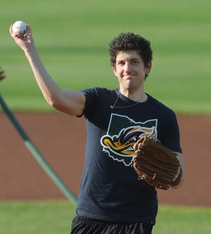 """""""Jeopardy"""" champion Matt Amodio of Medina throws out the first pitch before the Akron RubberDucks game against Altoona on Aug. 4 at Canal Park in Akron."""