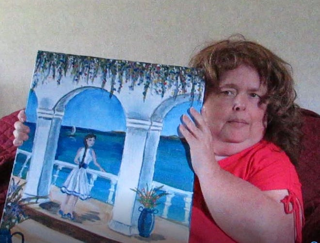 Reporter April Helms with one of her paintings.
