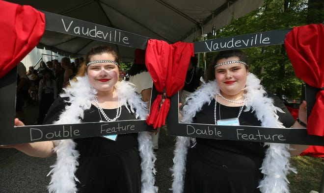Sisters Emily and Allison Richards, 23, of Buffalo, N.Y., dressed up as a double feature for the costume contest Saturday at the 46th Annual Twins Day Festival in Twinsburg. The twins took second place in their age group.