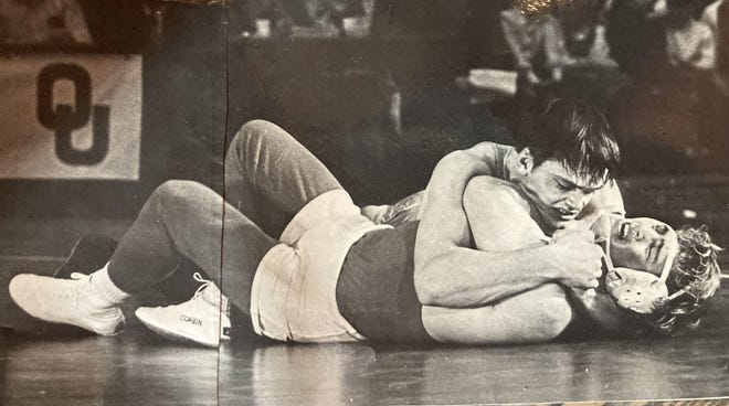 Gerald Winnard, top, works a move in a match during his career at Oklahoma State University. Winnard will be inducted into the  Oklahoma Chapter of the National Wrestling Hall of Fame on Oct. 10.