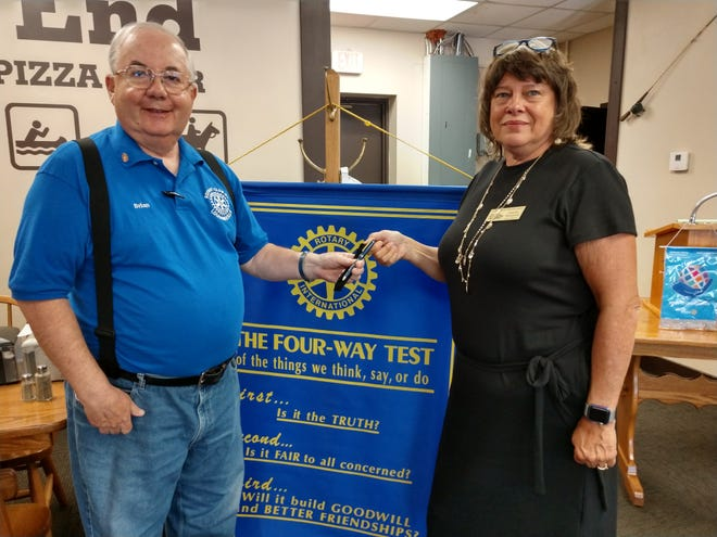Loudonville Rotary Club President Brian Hartzell presents a Rotary speaker's pen to Jennifer Marquette, director of the Ashland County Historical Society, who shared her perspective on Mohican Area History with Loudonville Rotarians on Thursday, Aug. 5.