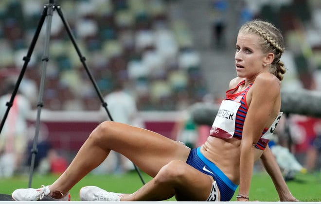 United States' Karissa Schweizer, a former Missouri standout, reacts after finishing the women's 10,000-meter final during the Tokyo 2020 Summer Olympic Games on Saturday at Olympic Stadium in Tokyo.
