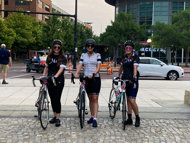 From left to right: Meagan Natale, Abigail McLean and Lauren Worley at McFerson Commons on Saturday. McLean, 31, of Columbus, is participating in her first Pelotonia ride after battling the blood cancer Hodgkins lymphoma.