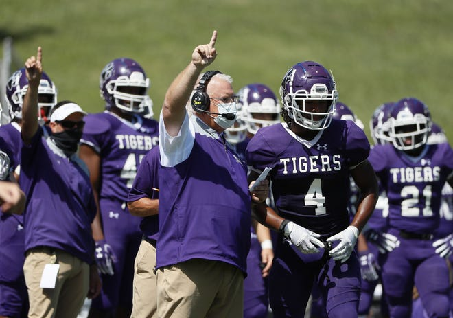 Pickerington Central coach Jay Sharrett calls a play from the sideline during last season's opener against Pickerington North. The Tigers open this season Aug. 20 at Massillon Washington in a battle of 2020 state runners-up.