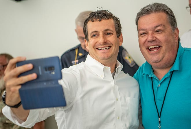Ninth District U.S. Rep. Trey Hollingsworth, R-Ind., takes a selfie with Ellettsville Town Council member William Ellis Aug. 15, 2019, at a lunch hosted by the Greater Ellettsville Chamber of Commerce. Republicans hold a number of local, state and federal offices that serve all or part of Monroe County, but no city offices in Bloomington.