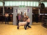 Joseph Johnson, owner of Dynamic Transportation, bought the grand champion 4-H lamb raised by Sydney Linn of Carleton for a whopping $40 a pound.