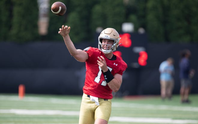 Notre Dame quarterback Jack Coan (17) passes the ball during practice on Saturday, Aug. 7, 2021.