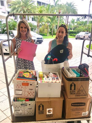 Nancy Stellway, executive director of Take Stock in Children, left, and Lidia Vargas, director of development, collect school supplies Aug. 3 from the Town of Palm Beach United Way. The agency distributed the supplies to low-income youth in Palm Beach County.
