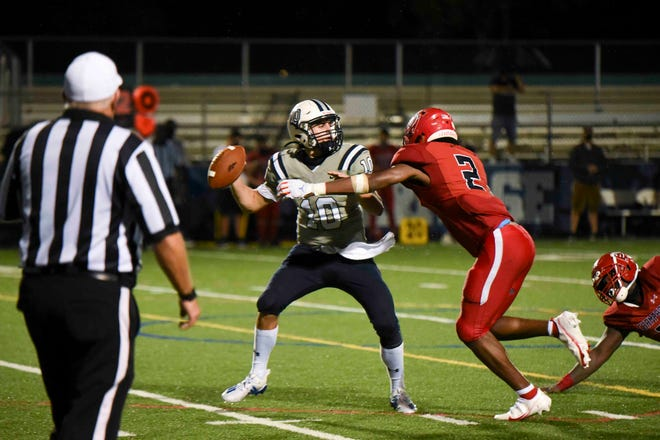 Then American Heritage quarterback Dylan Rizk attempts to pass against Champagnat Catholic last October. Rizk is now a junior at Cardinal Gibbons.