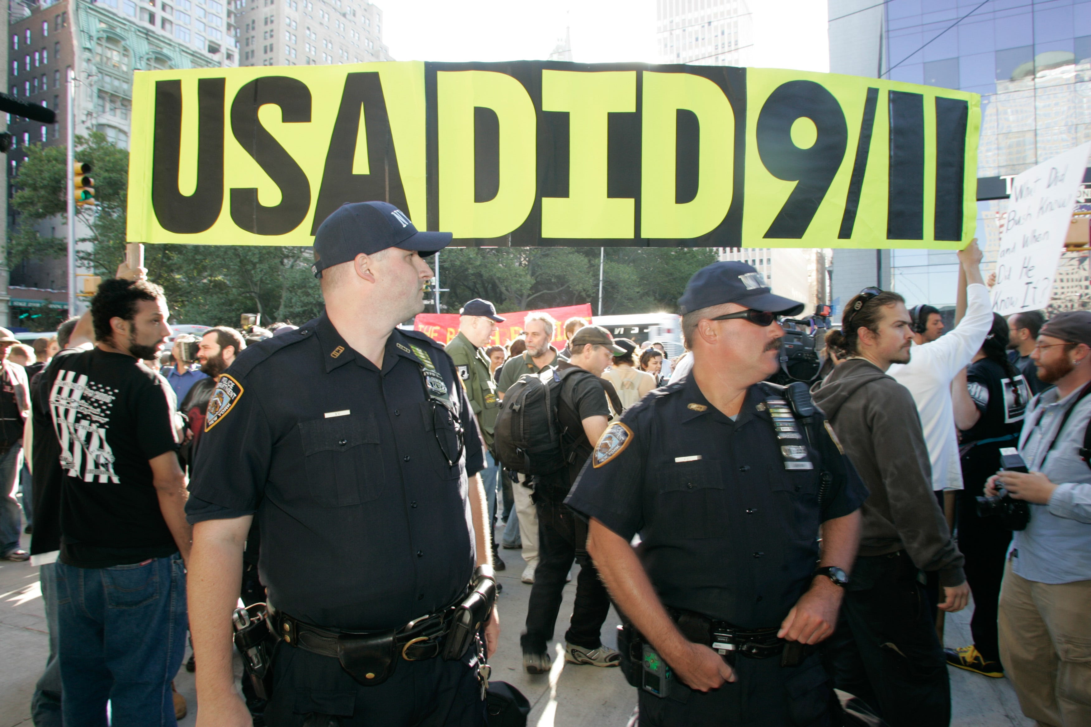 NYPD officers keep 9/11 conspiracy protesters out of the public memorial space during the 5th anniversary memorial at the former World Trade Center site.