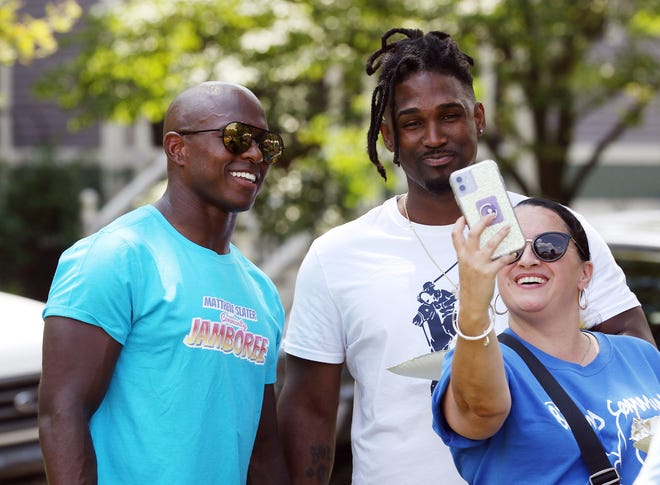 As Patriots receiver and special teams captain Matthew Slater and his wife, Shahrzad, host the inaugural Community Jamboree on Saturday at Dexter Training Ground in Providence, Slater, left, takes time to pose for a selfie with Thomas Lumpkins and Lisa Pina-Warren, both of whom are affiliated with the Nonviolence Institute. The Slater Family Foundation's Jamboree brought together more than 40 community groups and vendors in an attempt to provide area families with access to needed services.