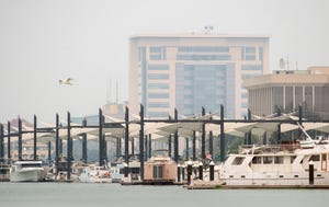 The San Joaquin County Courthouse, seen from the Morelli Park boat ramp about a mile away in downtown Stockton, is obscured by smoke that descended into the Central Valley from the Dixie and River fires in the Sierras on Friday.