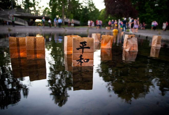 Paper lanterns float on the water of a pond at Alton Baker Park at the conclusion of an annual Hiroshima-Nagasaki Commemoration. The ceremony honors those who died when the U.S. dropped nuclear bombs on Hiroshima and Nagasaki in 1945 during World War II.