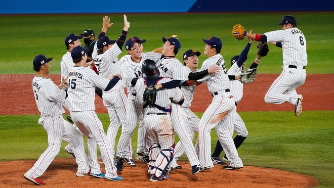 Japan celebrates after downing the U.S. 2-0 on Saturday in the gold medal baseball game at the Tokyo Olympics.