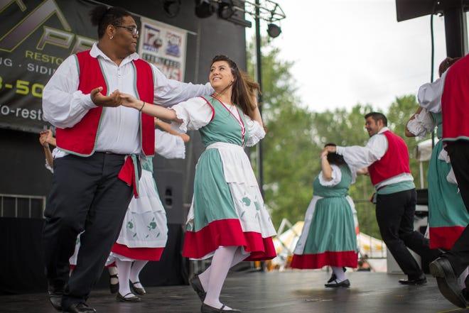 Amici Italiani Adult Troupe dances on stage during the Greater Rockford Italian American Association's 42nd annual Festa Italiana Fundraiser on Saturday, Aug. 7, 2021, at Boylan Catholic High School in Rockford.