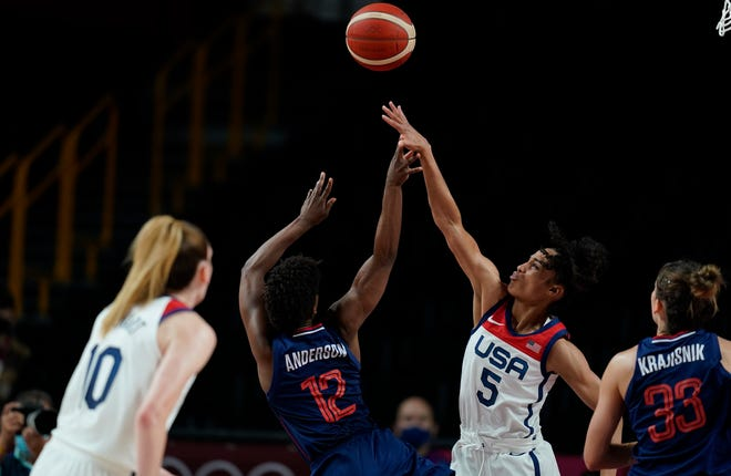 Serbia's Yvonne Anderson (12) shoots over United States' Skylar Diggins-Smith (5) during women's basketball semifinal game at the 2020 Summer Olympics, Friday, Aug. 6, 2021, in Saitama, Japan. (AP Photo/Charlie Neibergall)