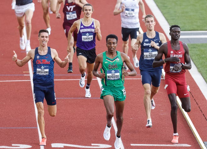Notre Dame runner Yared Nuguse, center, shown here during the NCAA championships in June 2021, had to pull out of the Olympic 1500 meter race because of an injury.
