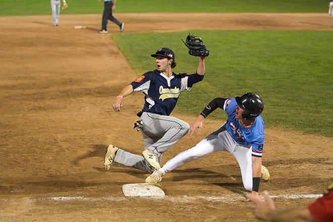 Shrewsbury's Seneca Hilcok makes the putout on Beverly's Tyler Petrosino at third base Friday night in an American Legion Northeast Regional game at Holy Cross.