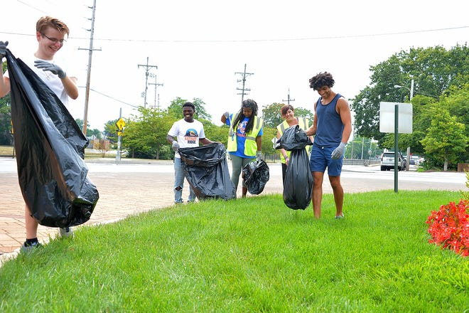 From left, Brett Guessford, Malik Phillips, Hagerstown City Councilwoman Tekesha Martinez, Hagerstown Mayor Emily Keller and Trevor Willard clean up trash along the traffic circle in front of City Park of Saturday morning as part of a cleanup initiative. The effort encouraged residents citywide to help clean up the streets. Trash bags and gloves were provided at various spots throughout Hagerstown.