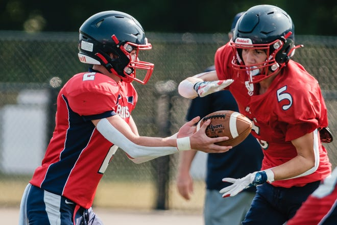 Indian Valley sophomore Sam Carter hands off to fellow sophomore Kolton Thomas in a scrimmage last month.