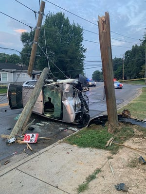 Three Louisville Metro Police officers rescued a driver trapped inside a burning vehicle that crashed Saturday, Aug. 7, 2021, at Winkler Avenue and Algonquin Parkway. The woman suffered life-threatening injuries, and an officer was treated for minor injuries.