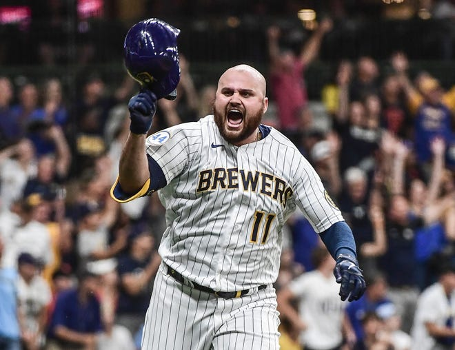 Brewers first baseman Rowdy Tellez celebrates his single that drove in Avisail Garcia in the 10th inning Friday night and beat the Giants at American Family Field.