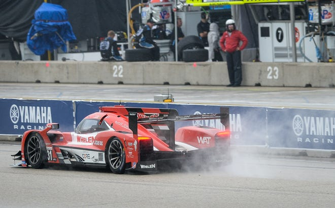 Felipe Nasr kicks up a spray while driving the Whelen Engineering Racing Cadillac DPi up the front straight during IMSA SportsCar Weekend qualifying Saturday at Road America.