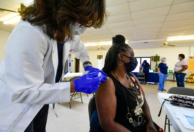 Michele Hill gets her Covid vaccine from RN Mary Battaglia as a Baptist Health vaccine clinic is held in partnership with Family Life Bible Fellowship Church in Montgomery, Ala., on Saturday August 7, 2021.