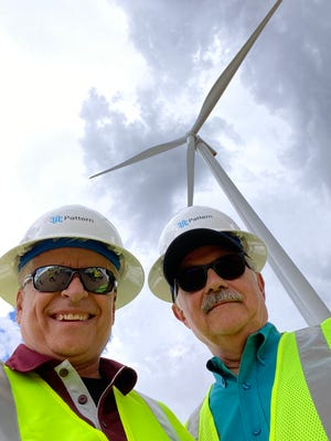 New Mexico State University Chancellor Dan Arvizu, left, and NMSU College of Agricultural, Consumer and Environmental Sciences Dean Rolando Flores visited a wind farm under construction at the Corona Range and Livestock Research Center outside of Corona, New Mexico.