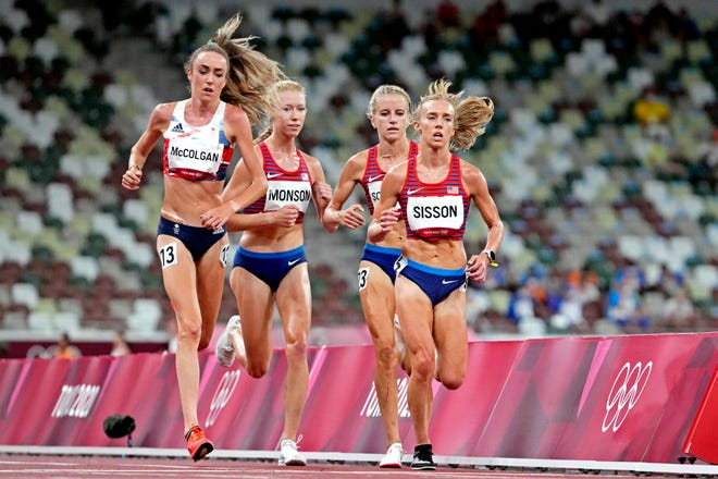 Aug 7, 2021; Tokyo, Japan; Alicia Monson (USA), Karissa Schweizer (USA) and Emily Sisson (USA) in the women's 10,000m final during the Tokyo 2020 Olympic Summer Games at Olympic Stadium.