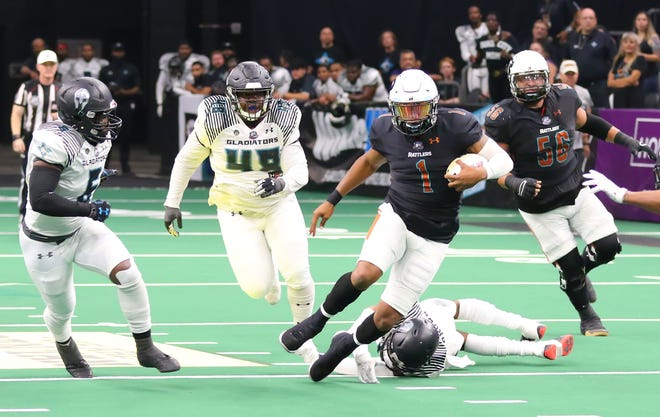 The running ability of Arizona Rattlers quarterback Drew Powell, seen here against Duke City on July 31, has him in the conversation for IFL offensive player of the year.