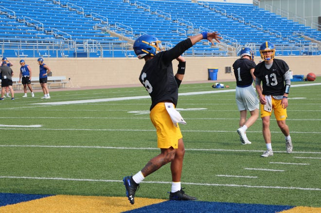 Chris Oladokun throws a pass during practice Thursday in Brookings.