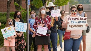 Parents and students hold a rally at Utah State School Board Office calling for mask mandate Friday, Aug. 6, 2021, in Salt Lake City.