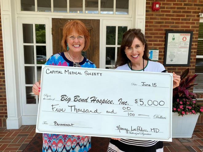 Big Bend Hospice Foundation President Dena Strickland was presented with a $5,000 grant check on June 16, 2021, by Capital Medical Foundation's Executive Director Pam Irwin for their bereavement program. The funding will be used for grief counseling and education on the processing of grief.